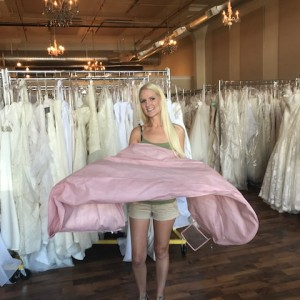 Carlee purchased her dress with us and chose to donate her dress back to us after her wedding!